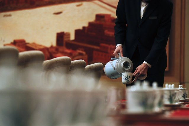 Hostesses fills tea cups for the Shanghai's delegates before a discussion group meeting on the sidelines of China's 19th Party Congress at the Great Hall of the People in Beijing, Thursday, October 19, 2017. (Photo by Andy Wong/AP Photo)