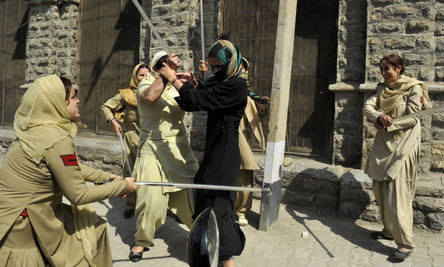 Indian police women beat female Kashmiri nursing students with batons during their arrest at a protest against their exam results in Srinagar on September 26, 2012. Indian police used batons to disperse a sit-in protest by female Kashmiri nursing students and detained some half a dozen during a protest against the results of their third year examinations which most of the students failed. (Photo by Tauseef Mustafa/AFP)