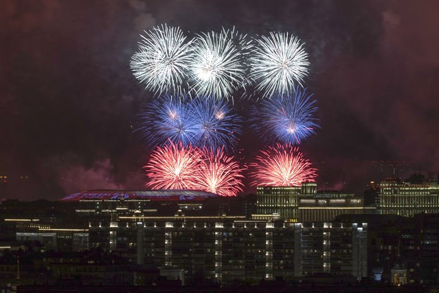 Fireworks explode over Moscow buildings during the celebration of the 75th anniversary of the Nazi defeat in World War II in Moscow, Russia, Saturday, May 9, 2020. Russian President Vladimir Putin has marked Victory Day, the anniversary of the defeat of Nazi Germany in World War II, in a ceremony shorn of its usual military parade and pomp by the coronavirus pandemic. (Photo by Denis Tyrin/AP Photo)