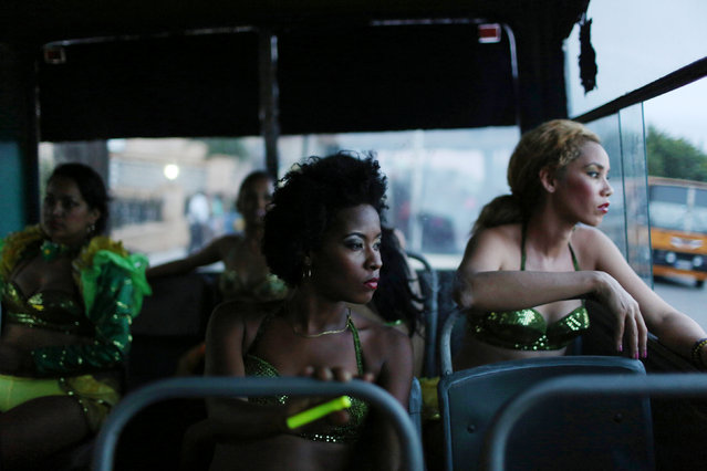 Revellers wait inside a bus before performing at a carnival parade in Havana, Cuba, August 12, 2016. (Photo by Alexandre Meneghini/Reuters)