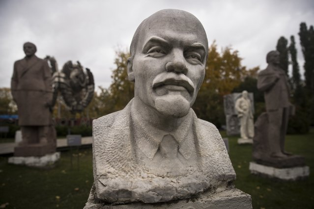 In this photo taken on Wednesday, October 11, 2017, a bust and other statues of Vladimir Lenin are displayed at the Musion park in Moscow, Russia. (Photo by Pavel Golovkin/AP Photo)