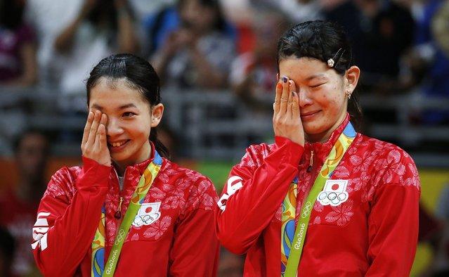 Ayaka Takahashi (R) and Misaki Matsutomo of Japan (L) celebrate their gold medal in the Rio 2016 Olympic Games Women's Badminton Doubles at the Riocentro in Rio de Janeiro, Brazil, 18 August 2016. (Photo by Esteban Biba/EPA)