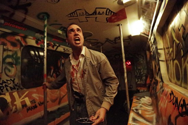 "In this October 2, 2014 photo, an actor performs during ""Nightmare: New York"", a haunted house attraction in New York. The ""Nightmare""  Lower East Side house  transports visitors to the city's ""bad old days"", including the demented rat-and-crime infested subway of the 1980s. (Photo by Frank Franklin II/AP Photo)"