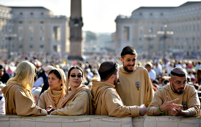 Franciscan wait for the arrival of Pope Francis before his general audience at St Peter's square on October 8, 2014 at the Vatican. (Photo by Andreas Solaro/AFP Photo)