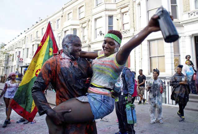 Revellers start the day's celebrations as Notting Hill Carnival begins on August 28, 2016 in London, England. (Photo by Ben A. Pruchnie/Getty Images)
