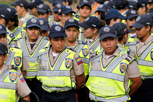 Police officers stand guard during a rally to demand a referendum to remove Venezuela's President Nicolas Maduro in Caracas, Venezuela, September 1, 2016. (Photo by Christian Veron/Reuters)