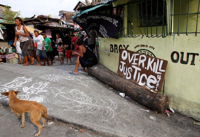 """A sign reading """"Overkill Justice for Eric"""" is pictured at the entrance of a street where Eric Quintinita Sison was killed in Pasay city, Metro Manila in the Philippines August 29, 2016. (Photo by Erik De Castro/Reuters)"""