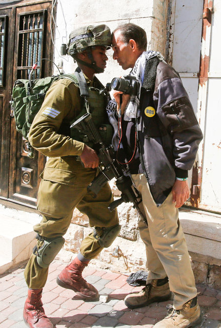 A foreign activist argues with an Israeli soldier during a protest in the West Bank city of Hebron February 24, 2017. (Photo by Mussa Qawasma/Reuters)