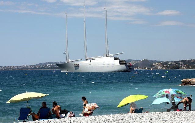 "The ""Sailing Yacht A"", the largest private sailing yacht in the world, is seen as holidaymakers enjoy the sunny weather on the beach following the outbreak of the coronavirus disease (COVID-19) in Cagnes-Sur-Mer, France, July 7, 2020. (Photo by Eric Gaillard/Reuters)"