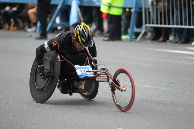 A man in the wheelchair division races in the 44th annual New York City Marathon in New York, Sunday, November 2, 2014. (Photo by Gordon Donovan/Yahoo News)