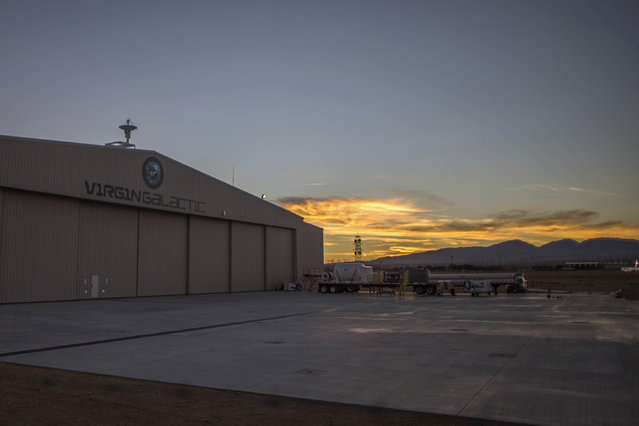The sun sets behind the Virgin Galactic hangar at Mojave Air and Space Port in Mojave. (Photo by Lucy Nicholson/Reuters)