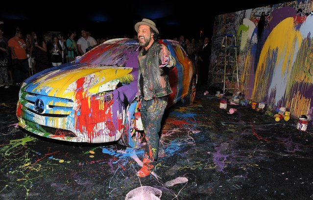 Artist Mr. Brainwash aka MBW attends the Mercedes-Benz Evolution Tour with Alabama Shakes & Young the Giant at The Barker Hangar on November 6, 2014 in Santa Monica, California. (Photo by Angela Weiss/Getty Images for Mercedes-Benz)