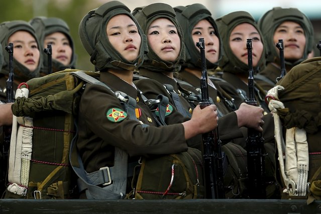 Soldiers look towards a stand with North Korean leader Kim Jong Un and other officials during the parade celebrating the 70th anniversary of the founding of the ruling Workers' Party of Korea, in Pyongyang October 10, 2015. Isolated North Korea marked the 70th anniversary of its ruling Workers' Party on Saturday with a massive military parade overseen by leader Kim Jong Un, who said his country was ready to fight any war waged by the United States. (Photo by Damir Sagolj/Reuters)