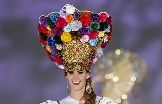 Fiorella Ximena Peirano Medina of Peru poses in national dress during the 54th Miss International Beauty Pageant in Tokyo November 11, 2014. Women from 74 countries took part in the annual beauty contest. (Photo by Thomas Peter/Reuters)