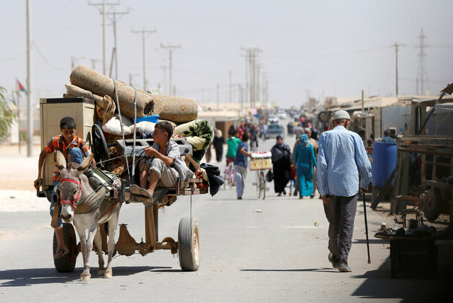 Syrian refugee children ride on a donkey-drawn cart in the Al-Zaatri refugee camp in the Jordanian city of Mafraq, Jordan, near the border with Syria September 17, 2016. (Photo by Muhammad Hamed/Reuters)