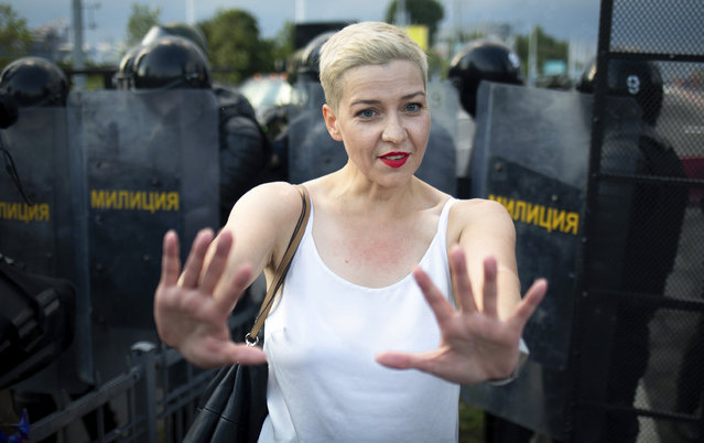 Maria Kolesnikova, one of Belarus' opposition leaders, center, gestures during a rally in Minsk, Belarus, Sunday, August 30, 2020. Tens of thousands of demonstrators have gathered in the capital of Belarus, beginning the fourth week of daily protests demanding that the country's authoritarian president resign. The protests began after an Aug. 9 presidential election that protesters say was rigged and officials say gave President Alexander Lukashenko a sixth term in office. (Photo by Tut.By via AP Photo)