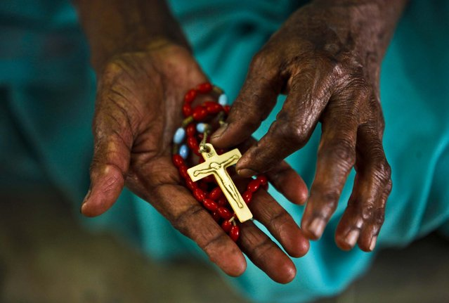 A woman holds a rosary and prays on Ash Wednesday at Saint Mary's Basilica in Hyderabad, India, on February 13, 2013.(Photo by Mahesh Kumar A./Associated Press)