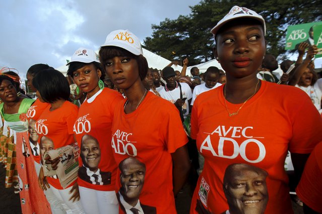 Supporters of Ivory Coast's President Alassane Ouattara and his party, the Rally of the Houphouetists for Democracy and Peace (RHDP), attend a campaign rally at the place inch alla in Abidjan October 20, 2015. Ouattara said on Monday he would push for constitutional reform if he wins re-election this week to scrap a nationality clause that helped drag his West African nation into a decade-long crisis. (Photo by Luc Gnago/Reuters)