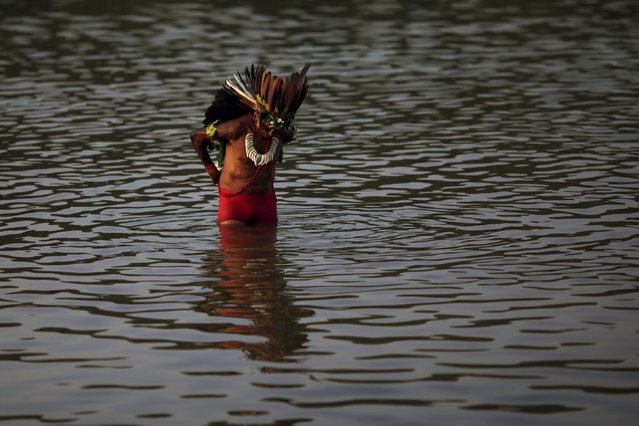 An indigenous man from the Tabajara tribe is seen in Tocantins river before the I World Games for Indigenous People in Palmas, Brazil, October 21, 2015. (Photo by Ueslei Marcelino/Reuters)