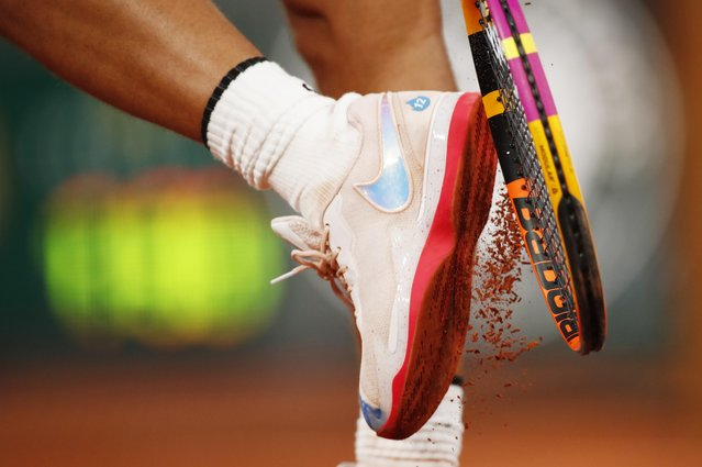 The number 12 is seen on the trainers belonging to Spain's Rafael Nadal during his first round match against Belarus' Egor Gerasimov at the French Open in Paris, France on September 28, 2020. (Photo by Gonzalo Fuentes/Reuters)