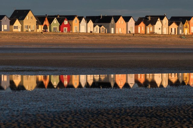 This picture shows beach huts in Ravenoville on August 06, 2020. (Photo by Joel Saget/AFP Photo)