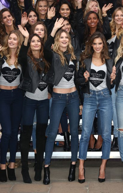 (2nd from left-r, front row) Karlie Kloss, Doutzen Kroes and Alessandra Ambrossio attend a photocall for the Victoria's Secret Angels ahead of the annual fashion show at Victoria's Secret New Bond Street on December 1, 2014 in London, England. (Photo by Tim P. Whitby/Getty Images)