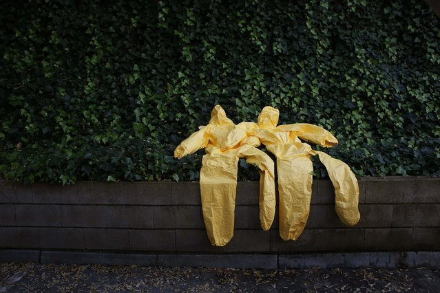 Protective suits are left to dry after an Ebola training session held by Spain's Red Cross in Madrid, in this October 29, 2014 file photo. (Photo by Susana Vera/Reuters)