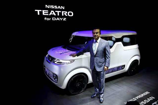 Carlos Ghosn, chief executive officer of Nissan Motor Co and Renault SA, poses in front of the Nissan Teatro for Dayz concept car at the 44th Tokyo Motor Show in Tokyo October 28, 2015. (Photo by Thomas Peter/Reuters)