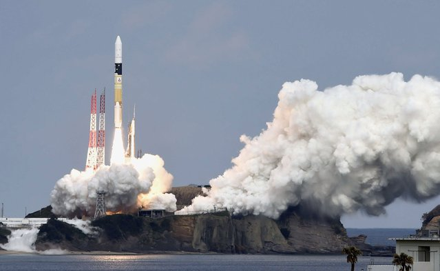 A H-IIA rocket carrying Hayabusa 2 space probe blasts off from the launching pad at Tanegashima Space Center on the Japanese southwestern island of Tanegashima, in this photo taken by Kyodo December 3, 2014. The Japanese space probe named for a falcon blasted off on Wednesday, setting off on a six-year round trip journey to an asteroid for samples that scientists hope will help reveal the origins of life. (Photo by Reuters/Kyodo News)
