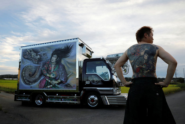 "Truck driver Hideyuki Haga, 44, poses in front of his truck which is decorated with the same design as his tattoo on his back, in Hiki, Saitama, Japan, September 3, 2020. ""When this painting was done I think I was about as excited as when my tattoo was done. The tattoo is now part of myself. I definitely feel proud of it"", said Haga. (Photo by Kim Kyung-Hoon/Reuters)"