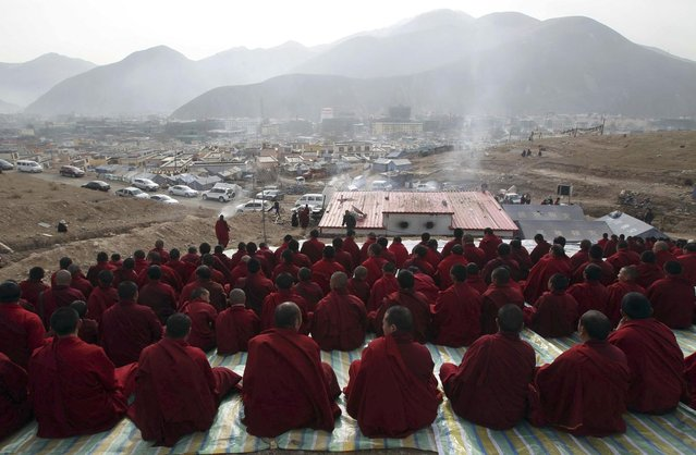Tibetan Buddhist monks attend a mass prayer in memorial for victims of the earthquake which hit Yushu county three years ago, in Yushu, Qinghai province April 14, 2013. The 7.1-magnitude earthquake that jolted Yushu of northwest China's Qinghai Province three years ago caused 2,698 people dead and 270 missing. Picture taken April 14, 2013. (Photo by Reuters/Stringer)