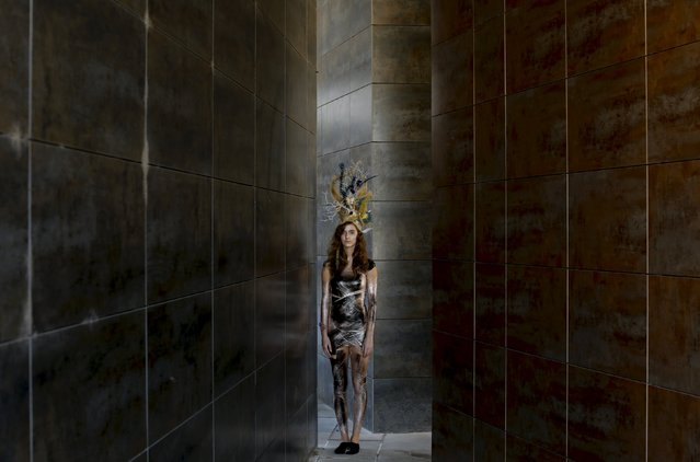 A model wearing a creation by Luis Benitez is pictured during an urban shoot as part of Andalucia de Moda (Andalusia Fashion) in Seville, southern Spain, November 11, 2015. (Photo by Marcelo del Pozo/Reuters)