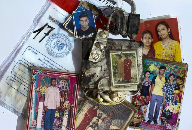 Unclaimed items that belonged to migrants who died during their journey to Europe are displayed in the homicide squad in the police department in Palermo, Italy November 4, 2015. Sandy and grimy, the watches, cell phones, family photos, $100 bills, and passports from Syria, Pakistan and Sudan are the tattered possessions of migrants who died at sea. Italian homicide police removed the items from the corpses of about 90 men, women and infants who perished aboard three different boats this summer. (Photo by Tony Gentile/Reuters)