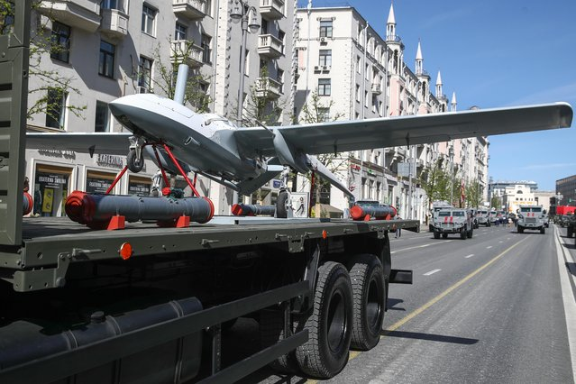 A military truck transports a Korsar tactical surveillance unmanned aerial vehicle (UAV) in Tverskaya Street ahead of a Victory Day military parade marking the 73rd anniversary of the victory over Nazi Germany in the 1941-1945 Great Patriotic War, the Eastern Front of World War II. (Photo by Valery Sharifulin/TASS via Getty Images)