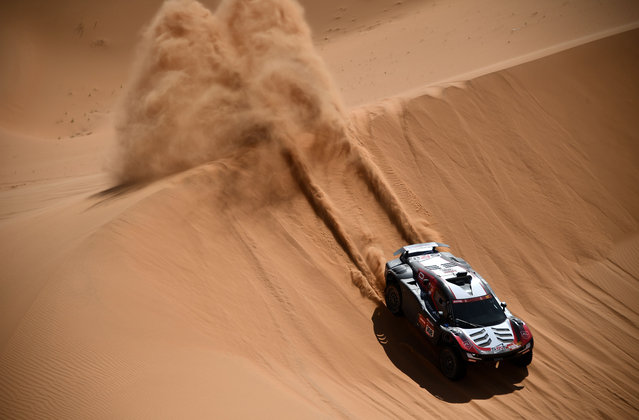 French driver Mathieu Serradori and co-driver Fabian Lurquin of Belgium compete during Stage 3 of the Dakar Rally around Wadi Ad-Dawasir, in Saudi Arabia, on January 5, 2021. (Photo by Franck Fife/AFP Photo)