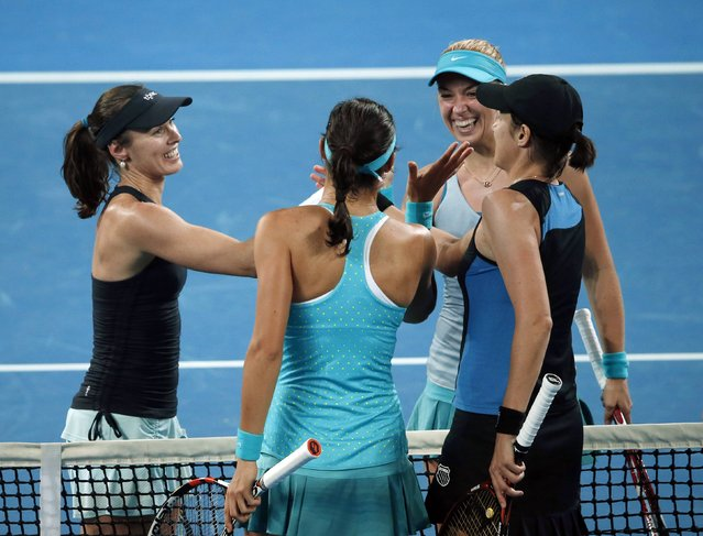 Martina Hingis (L) of Switzerland and Sabine Lisicki (2nd R) of Germany meet their opponents Caroline Garcia (L) of France and Katarina Srebotnik of Slovenia at the net after winning the women's doubles final match at the Brisbane International tennis tournament in Brisbane, January 10, 2015. (Photo by Jason Reed/Reuters)