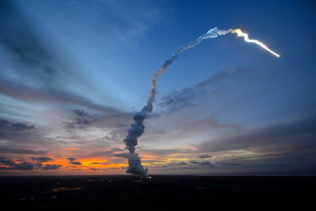 In this handout photo provided by the European Space Agency (ESA), Arianespace's unmanned Ariane 5 rocket, carrying the automated transfer vehicle (ATV) Albert Einstein, lifts off June 5, 2013 in Kourou, French Guiana along South America's northeast coast. The ATV will resupply the International Space Station with 14,500 pounds of propellant, food, experiments, water and oxygen. The mission marks the heaviest payload ever lifted by an Ariane rocket. (Photo by Stephane Corvaja/ESA via Getty Images)