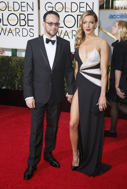 Producer Dana Brunetti and Katie Cassidy arrive at the 72nd Golden Globe Awards in Beverly Hills, California January 11, 2015. (Photo by Danny Moloshok/Reuters)