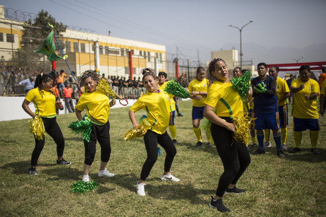 Inmates perform as cheerleaders during a soccer tournament inside the San Juan de Lurigancho prison, in Lima, Peru, Thursday, May 24, 2018. (Photoby Rodrigo Abd/AP Photo)