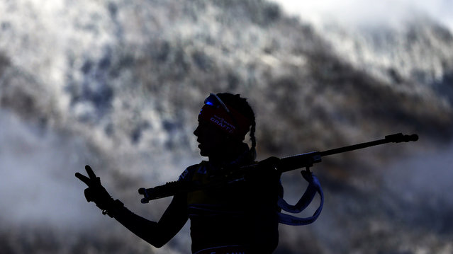 Kaisa Makarainen of Finland gestures to her coaches as she warms up prior to the women's 12.5 km mass start at the Biathlon World Cup in Ruhpolding, Germany, Sunday, January 18, 2015. (Photo by Matthias Schrader/AP Photo)