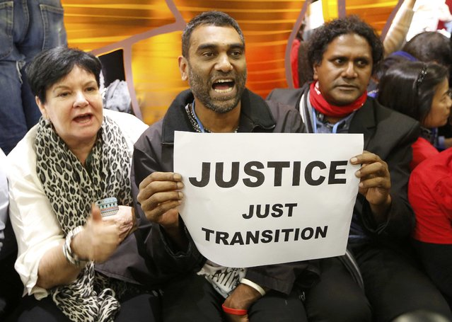 Australia's Sharan Burrow (L), General Secretary of International Trade Union Confederation, and Greenpeace International director Kumi Naidoo (C) attend a demonstration inside the World Climate Change Conference 2015 (COP21) in Le Bourget, near Paris, France, December 9, 2015. (Photo by Jacky Naegelen/Reuters)