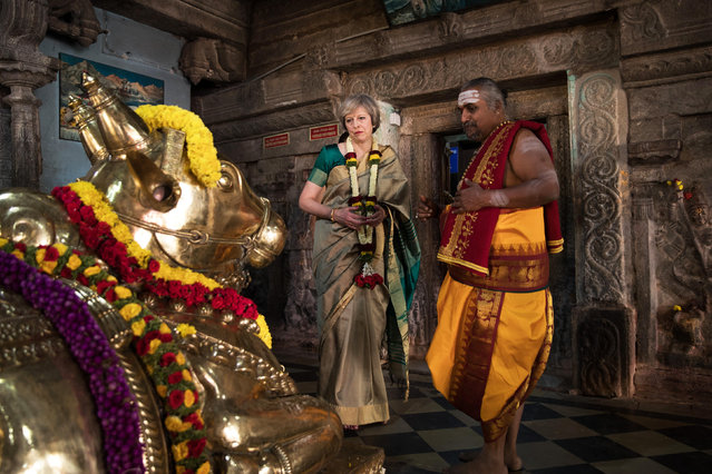 British Prime Minister Theresa May is welcomed to the Sri Someshwara Temple on November 8, 2016 in Bangalore, India. Mrs May is in India on a two day trade mission to reconnect the UK with the Commonwealth during her first trip since taking office. Yesterday the Prime Minister met with Indian Prime Minister Narendra Modi. (Photo by Dan Kitwood/Getty Images)