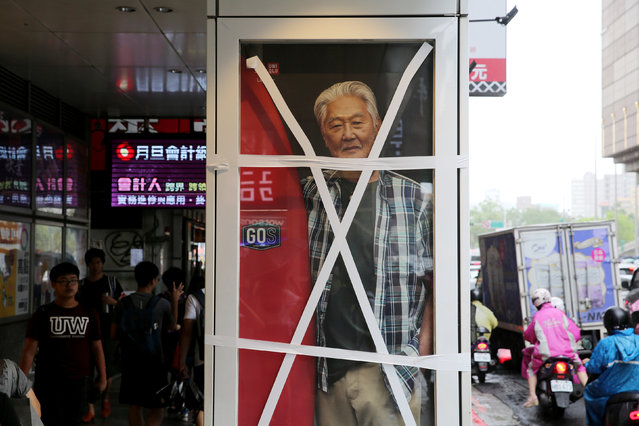 An advertisement display window is taped on a street in Taipei as Taiwan braced for super typhoon Maria on July 10, 2018. (Photo by Eason Lam/Reuters)