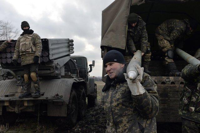 Ukrainian servicemen unload Grad rockets from a truck before launching them towards pro-Russian separatist forces outside Debaltseve, eastern Ukraine February 8, 2015. (Photo by Alexei Chernyshev/Reuters)