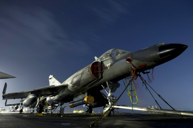 A French Super Etendard fighter jet parked on the flight deck of France's Charles de Gaulle aircraft carrier is seen in Manama December 31, 2015. (Photo by Kenzo Tribouillard/Reuters)