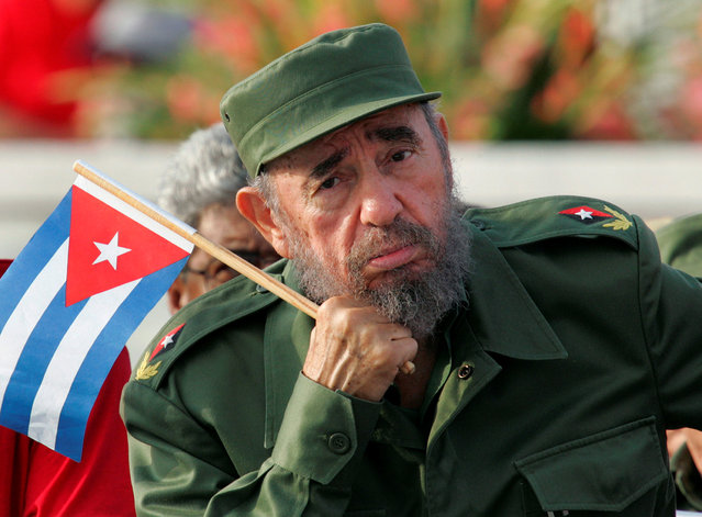 Cuban President Fidel Castro listens to a speaker during the May Day parade in Havana's Revolution Square in this May 1, 2005 file photo. (Photo by Claudia Daut/Reuters)