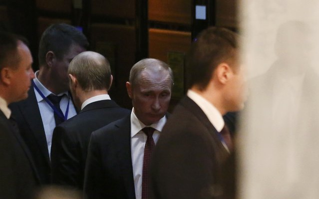 Russia's President Vladimir Putin (C) uses an elevator as he attends a peace summit to resolve the Ukrainian crisis in Minsk, February 12, 2015. (Photo by Vasily Fedosenko/Reuters)