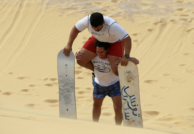 A man carries his friend while climbing in Wadi el-Rayan Fayoum, Egypt, November 18, 2016. (Photo by Mohamed Abd El Ghany/Reuters)