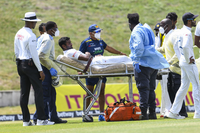 Lasith Embuldeniya of Sri Lanka is taken off the field by medical team during day 4 of the 2nd Test between West Indies and Sri Lanka at Vivian Richards Cricket Stadium in North Sound, Antigua and Barbuda, on April 1, 2021. (Photo by Randy Brooks/AFP Photo)