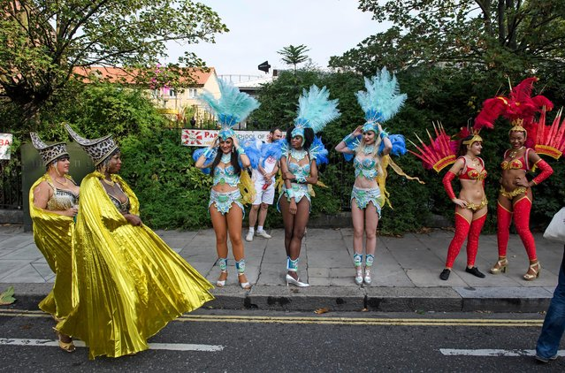 Revellers take part in the Notting Hill Carnival in London, Britain on August 27, 2018. (Photo by London News Pictures)